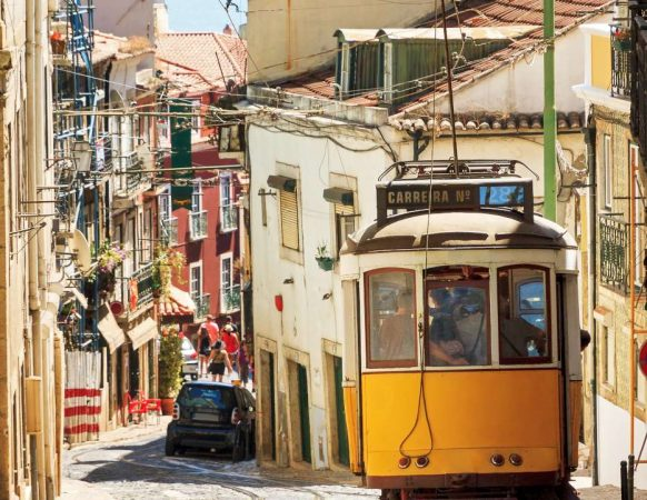 Beautiful traditional yellow tram in the streets of Lisbon-1400