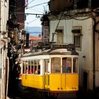Beautiful traditional yellow tram in the streets of Lisbon1-1400