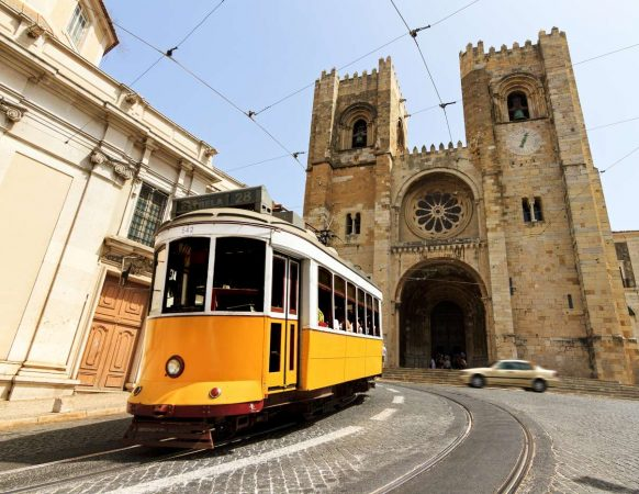 The Lisbon Cathedral with a traditional yellow tram in Lisbon-1400