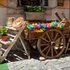 typical portuguese ceramics and small old wooden cart at the doors of a craft shop in Lisbon, Portugal-1400