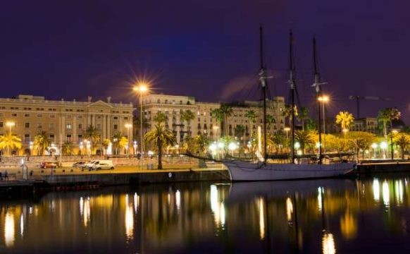 Night view of embankment in the port of Barcelona Spain-600