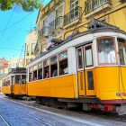 Beautiful image of the traditional yellow trams in Lisbon,-1400