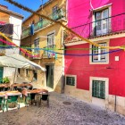 Beautiful wide angle image of the tight streets with lots of colors in Lisbon-1400