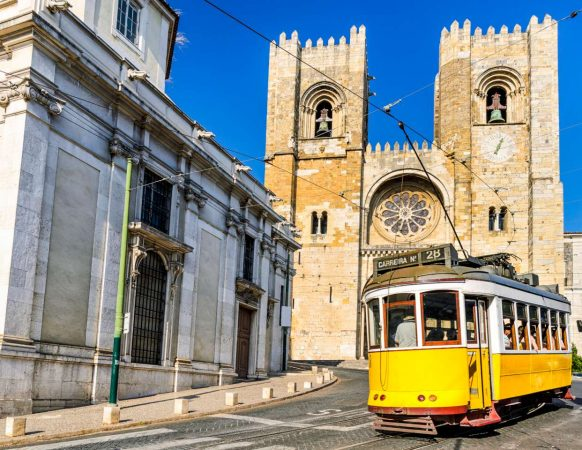 Historic yellow tram in front of the Lisbon Cathedral, Portugal-1400