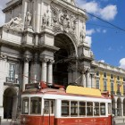 Old touristic tramway at the Comercio Square in Lisbon-1400