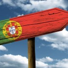 Portugal flag wooden sign with a beautiful sky on background – Europe-1400