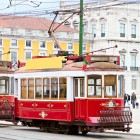 historic classic red tram of Lisbon built partially of wood in front-1400